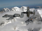 A-10 Thunderbolt II's Fly Over Mountainous Landscape Photographic Print by Stocktrek Images