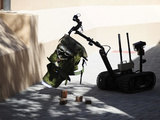 Talon Remote-controlled Robot Investigates An Improvised Explosive Device Photographic Print by Stocktrek Images