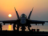 Sailors Prepare An F/A-18C Hornet For Flight Operations Aboard USS John C. Stennis Photographic Print by Stocktrek Images