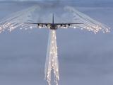 MC-130H Combat Talon Dropping Flares Photographic Print by Stocktrek Images