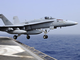 An F/A-18C Hornet Catapults from the Aircraft Carrier USS Ronald Reagan Photographic Print by Stocktrek Images