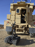 A Talon Mark 2 Bomb Disposal Robot Is Deployed from a Rapid Response Vehicle Photographic Print by Stocktrek Images