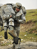 A Soldier Transports a Fellow Wounded Soldier Using the Fireman's Carry Technique Photographic Print by Stocktrek Images