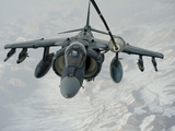 An A/V-8B Harrier Receives Fuel Over Afghanistan from a KC-10 Extender Photographic Print by Stocktrek Images