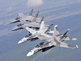 Two F/A-18 Hornets And Two F-15 Strike Eagles Fly in An Echelon Formation Photographic Print by Stocktrek Images