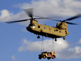 A U.S. Army CH-47 Chinook Helicopter Transports a Humvee Photographic Print by Stocktrek Images
