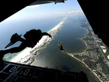 U.S. Airmen Jump Out of a C-130 Hercules Photographic Print by Stocktrek Images