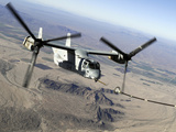 A Marine Corps MV-22 Osprey Prepares To Refuel Midflight Photographic Print by Stocktrek Images