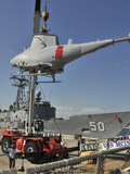 An MQ-8B Fire Scout Is Craned of USS McInerney Photographic Print by Stocktrek Images