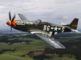 A North American P-51 Mustang in Flight Over Vasteras, Sweden Photographic Print by Stocktrek Images