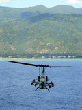 An AH-1W Super Cobra Flies Off the Coast of Dili, East Timor Photographic Print by Stocktrek Images