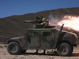 A Missileman Firing a BGM-71 TOW Missile Atop a Humvee Photographic Print by Stocktrek Images