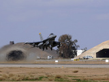 An F-16 Fighting Falcon Takes Off from Balad Air Base, Iraq Photographic Print by Stocktrek Images