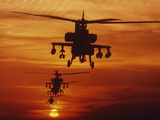 Four AH-64 Apache Anti-armor Helicopters Fly in Formation at Dusk Photographic Print by Stocktrek Images