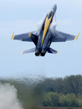 Lead Solo Pilot of the Blue Angels Performs a High Performance Climb Photographic Print by Stocktrek Images