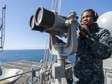 Seaman Stands Lookout Aboard the Aircraft Carrier USS Harry S. Truman Photographic Print by Stocktrek Images