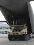 A Humvee Is Deployed from a C-130J Super Hercules Photographic Print by Stocktrek Images