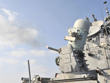 A Phalanx Close-in Weapons System Is Fired Aboard USS Lassen Photographic Print by Stocktrek Images