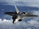 A U.S. Air Force F-22 Raptor Aircraft Flies Near Guam Photographic Print by Stocktrek Images