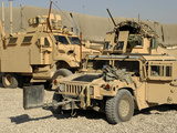 A M1114 Humvee Sits Parked in Front of a MaxxPro MRAP Photographic Print by Stocktrek Images