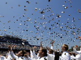 Graduates of the U.S. Naval Academy Throw Their Hats Into the Air Photographic Print by Stocktrek Images