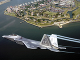 A F/A 22 Raptor Flies Over Fort Monroe Photographic Print by Stocktrek Images