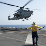An AH-1Z Cobra Helicopter Takes Off from the Flight Deck of USS Makin Island Photographic Print by Stocktrek Images