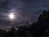 A Bright Moon Rises Through Clouds Over a Hill in Oklahoma Photographic Print by Stocktrek Images