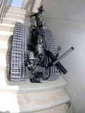 A Talon 3B Robot Unit Climbing a Flight of Stairs During a Training Mission in Bahrain Photographic Print by Stocktrek Images