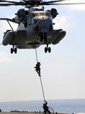 Marines Rappel from a CH-53E Sea Stallion Helicopter Photographic Print by Stocktrek Images