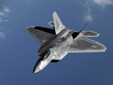 A F-22 Raptor Returns To a Mission After Refueling Photographic Print by Stocktrek Images