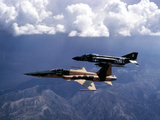 An F-5 Tiger II And F-4 Phantom II During a Tactics Development Flight Photographic Print by Stocktrek Images