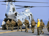 Marines Board a CH-46E Sea Knight Helicopter Photographic Print by Stocktrek Images