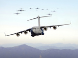 A Formation of 17 C-17 Globemaster IIIs Fly Over the Blue Ridge Mountains Photographic Print by Stocktrek Images