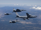 A KC-135R Stratotanker Refuels Three F-15 Eagles Photographic Print by Stocktrek Images