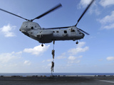 A Trio of Marines Fast Rope from a CH-46E Sea Knight Helicopter Photographic Print by Stocktrek Images