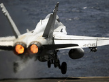 An F/A-18C Hornet Launches from USS Abraham Lincoln Photographic Print by Stocktrek Images