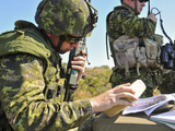 Canadian Army Captain Radios a Close Air Support Mission Photographic Print by Stocktrek Images