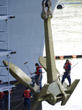 Sailors Paint the Starboard Anchor of the Aircraft Carrier USS Nimitz Photographic Print by Stocktrek Images