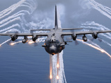 An AC-130H Gunship Aircraft Jettisons Flares As An Infrared Countermeasure Photographic Print by Stocktrek Images