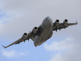 A Boeing C-17 Globemaster III Taking Off from Nellis Air Force Base Photographic Print by Stocktrek Images