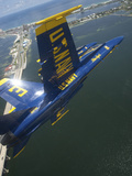 An F/A-18 Hornet of the Blue Angels Over Pensacola Beach, Florida Photographic Print by Stocktrek Images