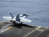 An F/A-18F Super Hornet Launches from the Aircraft Carrier USS Enterprise Photographic Print by Stocktrek Images