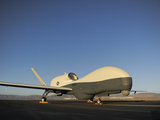 An RQ-4 Global Hawk Unmanned Aerial Vehicle Sits On the Flight Line Photographic Print by Stocktrek Images