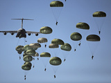 U.S. Army Paratroopers Jumping Out of a C-17 Globemaster III Aircraft Photographic Print by Stocktrek Images