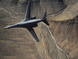 A B-1B Lancer Maneuvers Over New Mexico During a Training Mission Photographic Print by Stocktrek Images