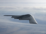 A B-2 Spirit Soars Through the Sky Photographic Print by Stocktrek Images