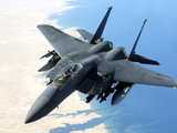 An F-15E Strike Eagle Flies Over Iraq During a Combat Mission Photographic Print by Stocktrek Images