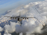 An AC-130U Gunship Jettisons Flares Over Florida Photographic Print by Stocktrek Images