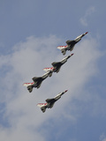 The U.S. Air Force Thunderbirds Fly in Formation Photographic Print by Stocktrek Images
